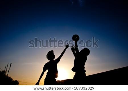 silhouette of man playing basketball - stock photo