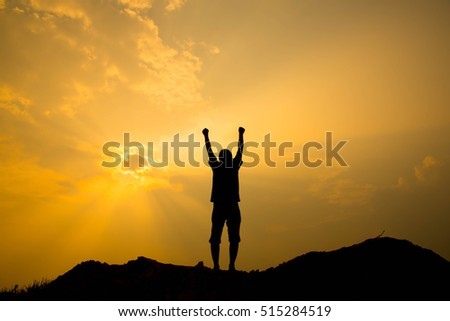 Silhouette of man standing on the top of mountain