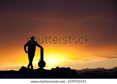 Silhouette of Man With Banjo - stock photo