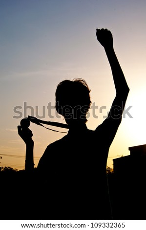 silhouette of man with medal prize - stock photo