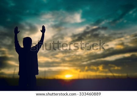 Silhouette of man with raised hands over blur sea concept for religion, worship, prayer and praise. sunset sunrise light Assumption of Mary, Feast life freedom peace appeal psalm bible France Syrian