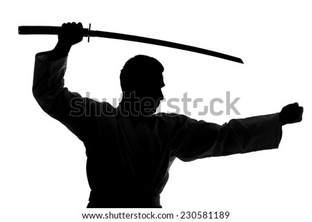 Silhouette of martial arts man is standing with a sword, isolated on the white background. - stock photo