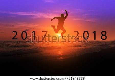 Silhouette of men jumping above the sea from year 2017 to year 2018, new year, business successful concept.