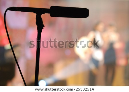 Silhouette of microphone on stand - stock photo