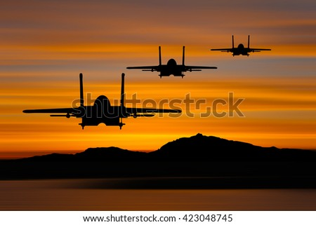 Silhouette of military airplane with sunset background