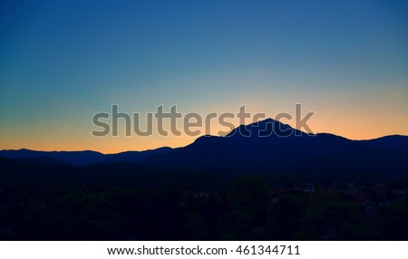 Silhouette of mountain at sunset.