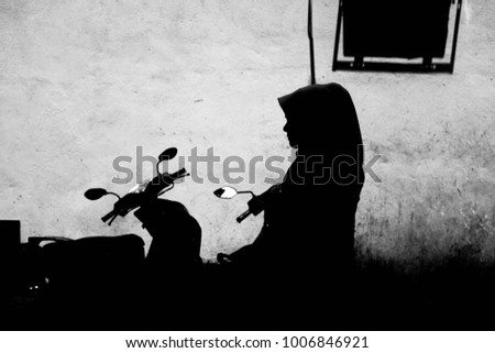Silhouette of muslim women with hijab. Concept of unknown muslim women