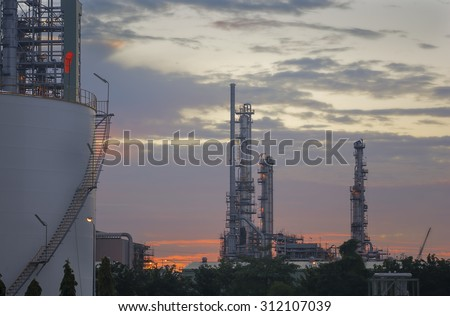 Silhouette of Oil and gas refinery at twilight  - stock photo