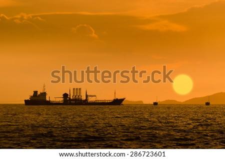 Silhouette of Oil exploration vessel - stock photo