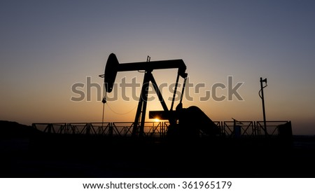Silhouette of oil pump at Bahrain oil field.