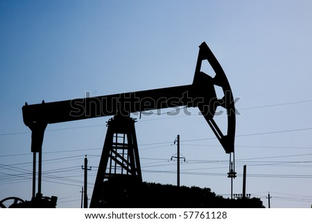 Silhouette of oil pump jacks - stock photo