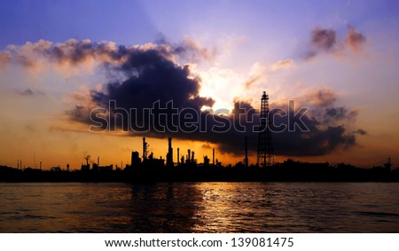 Silhouette of oil refinery at sunrise in Bangkok, Thailand - stock photo