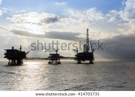 Silhouette of oil rig or platform at oilfield in Malaysia