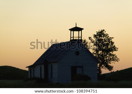 Silhouette of old school house in South Dakota - stock photo