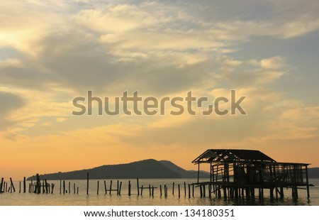 Silhouette of old wooden jetty at sunrise, Koh Rong island, Cambodia, Southeast Asia