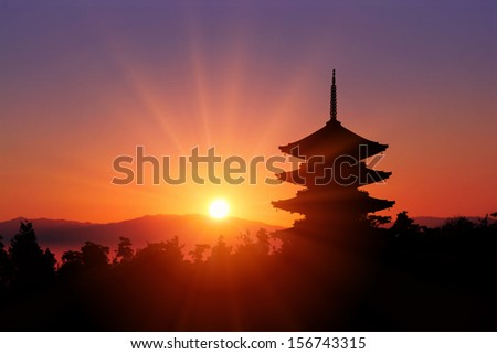 Silhouette of pagoda during sunset - stock photo