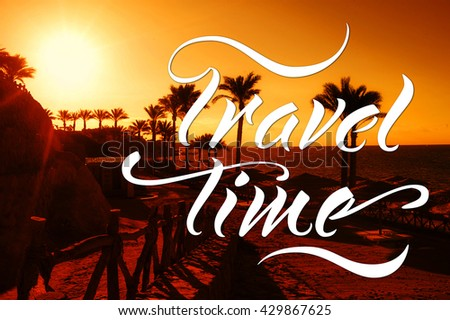 silhouette of palm trees against setting sun. Words travel time - stock photo