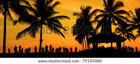 silhouette of people and tourist during a beautiful sunset