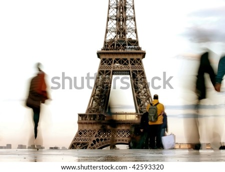 silhouette  of people in front of the Eiffel tower