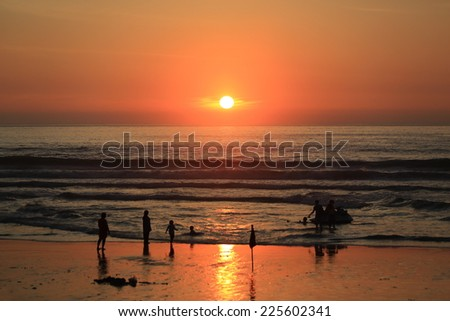 Silhouette of people on the beach and Beautiful Sea Sunset