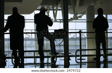 silhouette of people waiting at the airport - stock photo