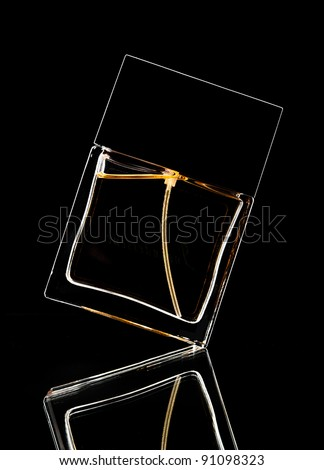 Silhouette of perfume bottle on a black backdrop - stock photo