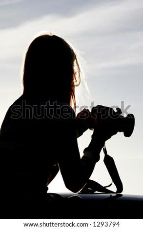 Silhouette of photographer - stock photo