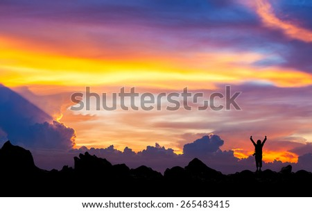 Silhouette of photographer at  mountain with beautiful  sunset sky. Conceptual scene.