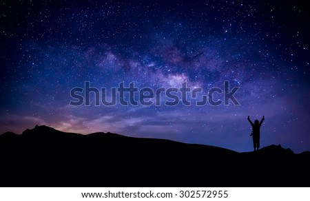 Silhouette of photographer at  mountain with milky way in the sky. Conceptual scene. - stock photo