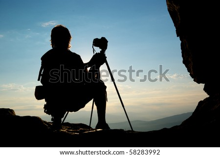 Silhouette of photographer in mountain. Element of design. - stock photo