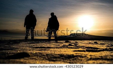 silhouette of photographer on snow in landscape winter time - stock photo