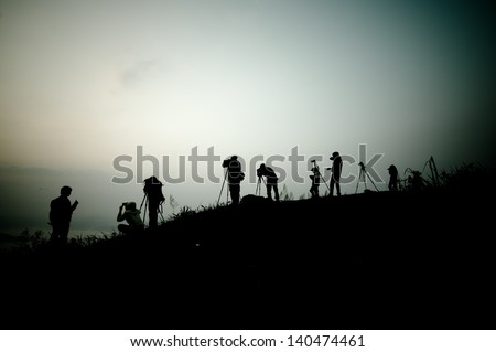 Silhouette of photography on the cliff. Phu Chee Fah Thailand.