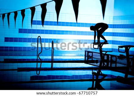 silhouette of player on starting platform on swimming pool - stock photo