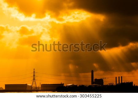 silhouette of power plant on evening background