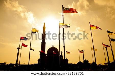 Silhouette of Putra Mosque in sunset. Putrajaya, Malaysia. - stock photo