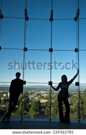 Silhouette of romantic couple in front of a big window