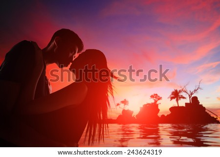 silhouette of romantic lovers hug with sea ocean and beautiful sunset in Boracay, Philippines - stock photo