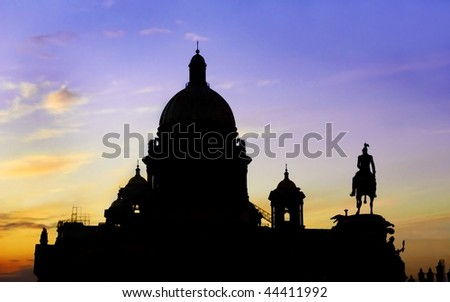 Silhouette of Saint Isaac's Cathedral or Isaakievskiy Sobor in Saint Petersburg, Russia and Peter the great (far right).