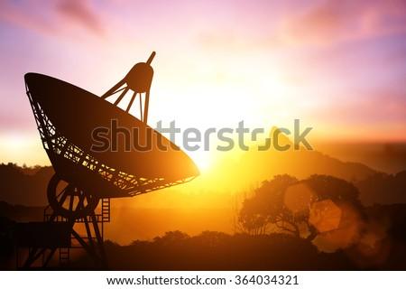 Silhouette of satellite dish - stock photo