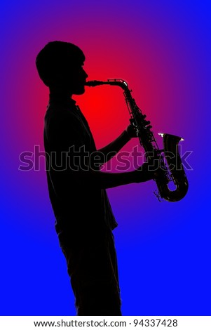Silhouette of Saxophone Player against Colorful Background