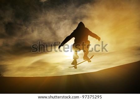 silhouette of skateboarder - stock photo