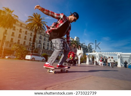 Silhouette of skateboarder jumping in city on background the central promenade in Cannes France - stock photo