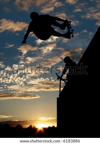 Silhouette of skateboarder on ramp 2 - stock photo