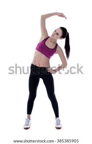 silhouette of slim woman in sports wear doing stretching exercises isolated on white background - stock photo