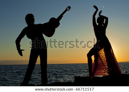 silhouette of Spanish dancers at sunset at vacation resort  in Spain, MALLORCA - stock photo
