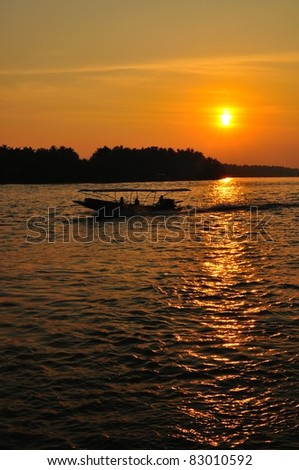 silhouette of speed boat running in the river of Bangpakong, Ampawa, Thailand. - stock photo