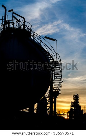 silhouette of sphere gas storage tank in morning time