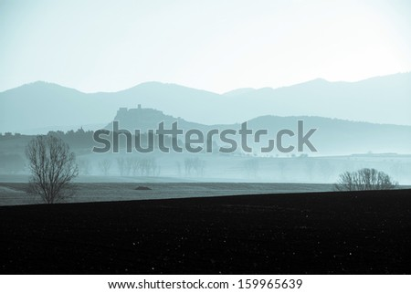 silhouette of St. Martin's Cathedral at Spisska Kapitula and Spis castle in the background, Slovakia - stock photo