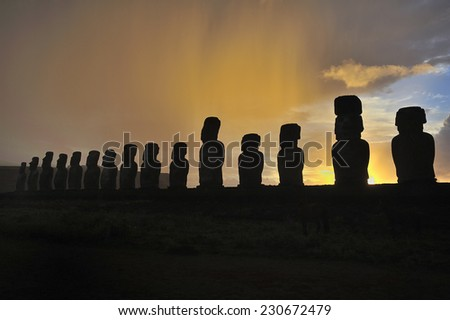 Silhouette of standing Moais at sunrise in Easter Island, Chile