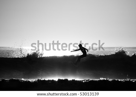 Silhouette of Surfer in the Ocean - stock photo